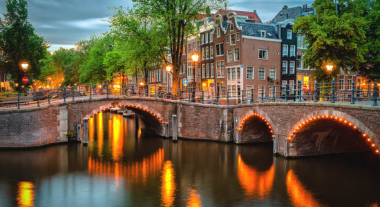 Canal bridges in Amsterdam with lights